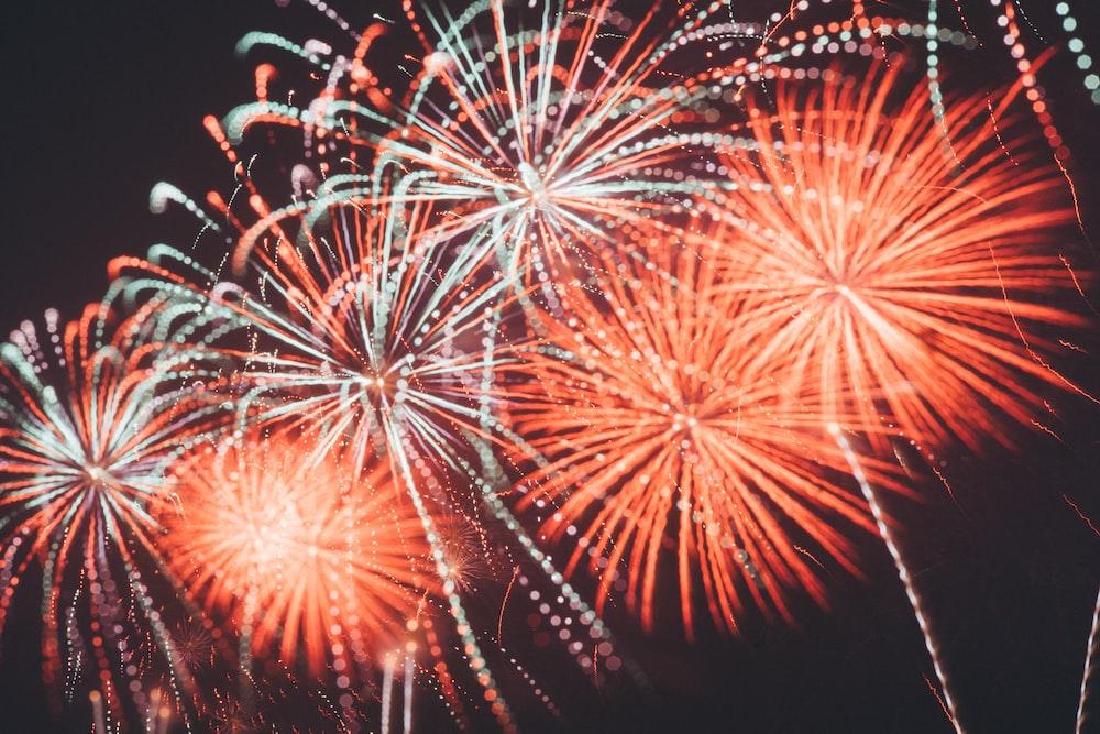 photo of orange and white fireworks