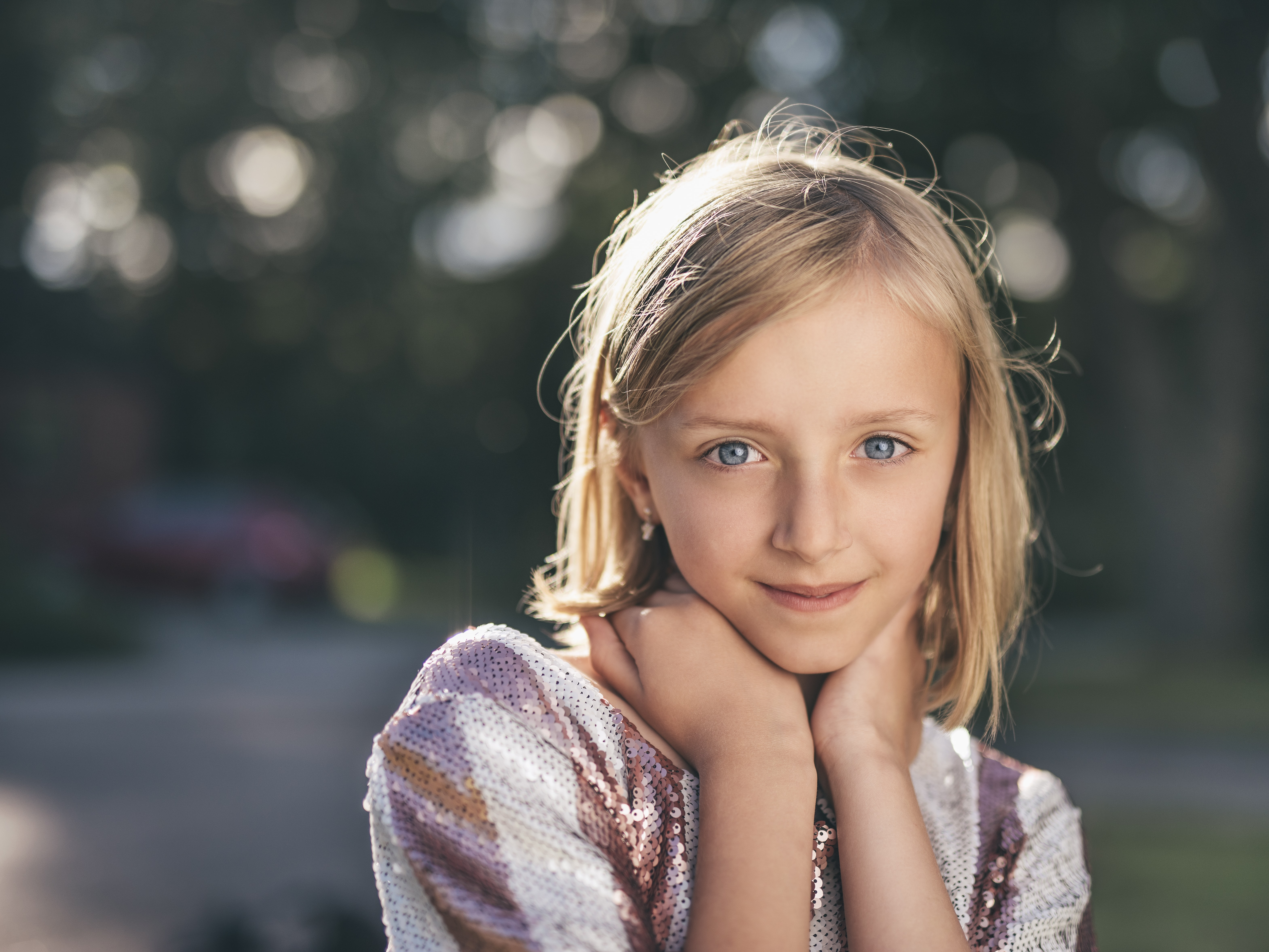 selective focus photography of girl in sequined white-and-pink stripe shirt