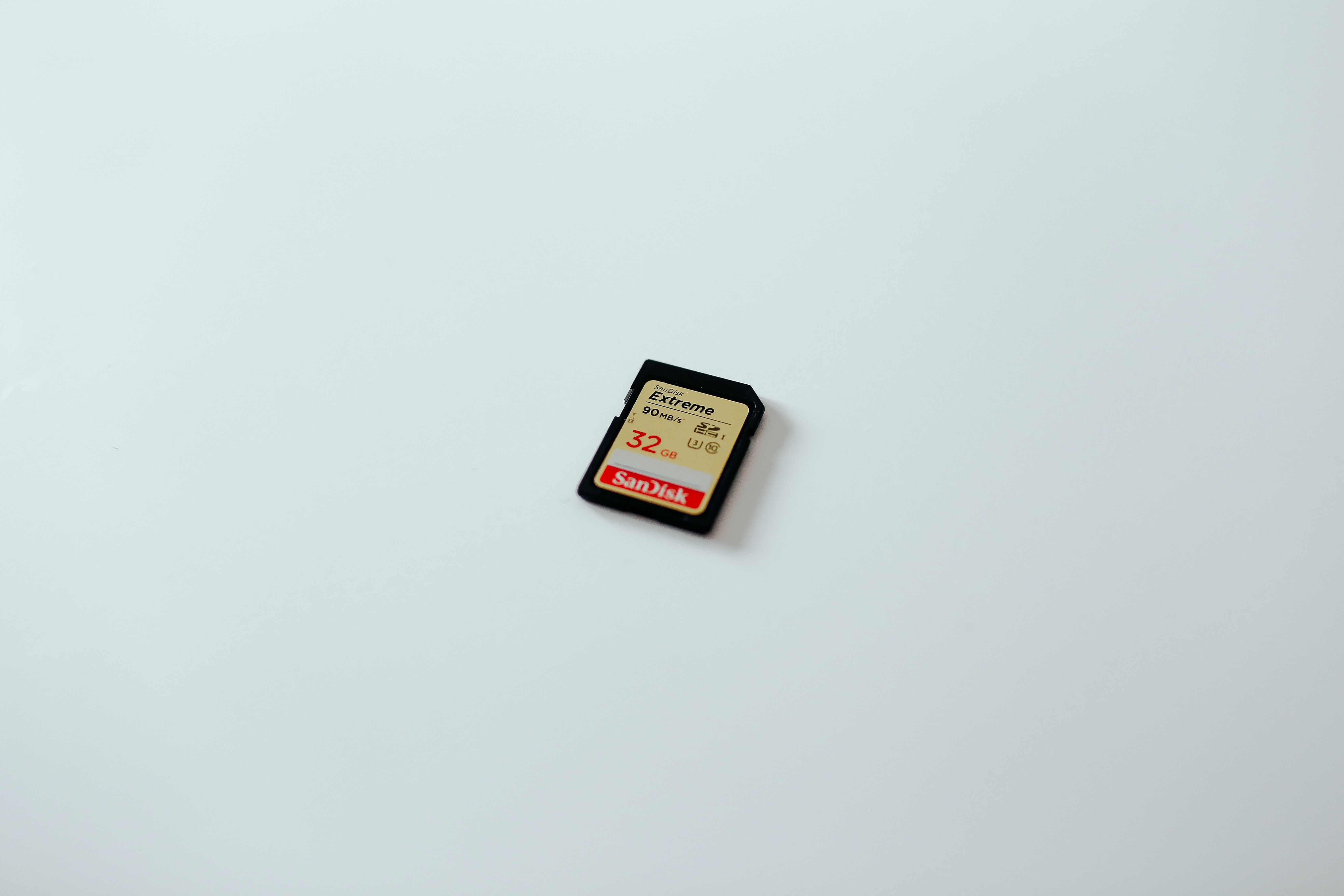 An SD card against a solid-colored background.