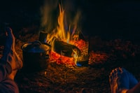 gray steel cooking pot beside the flame