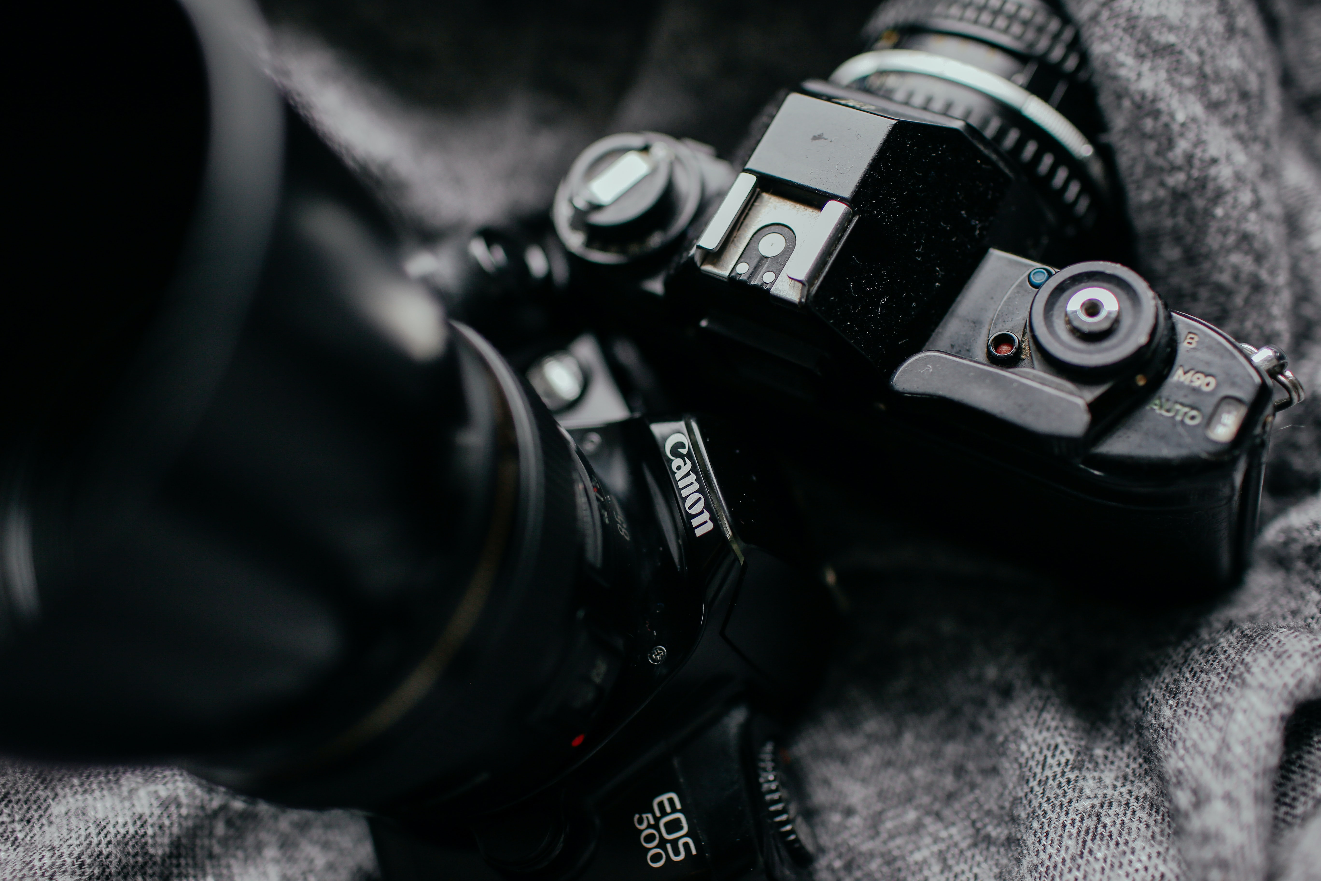 focus photography of two DSLR cameras