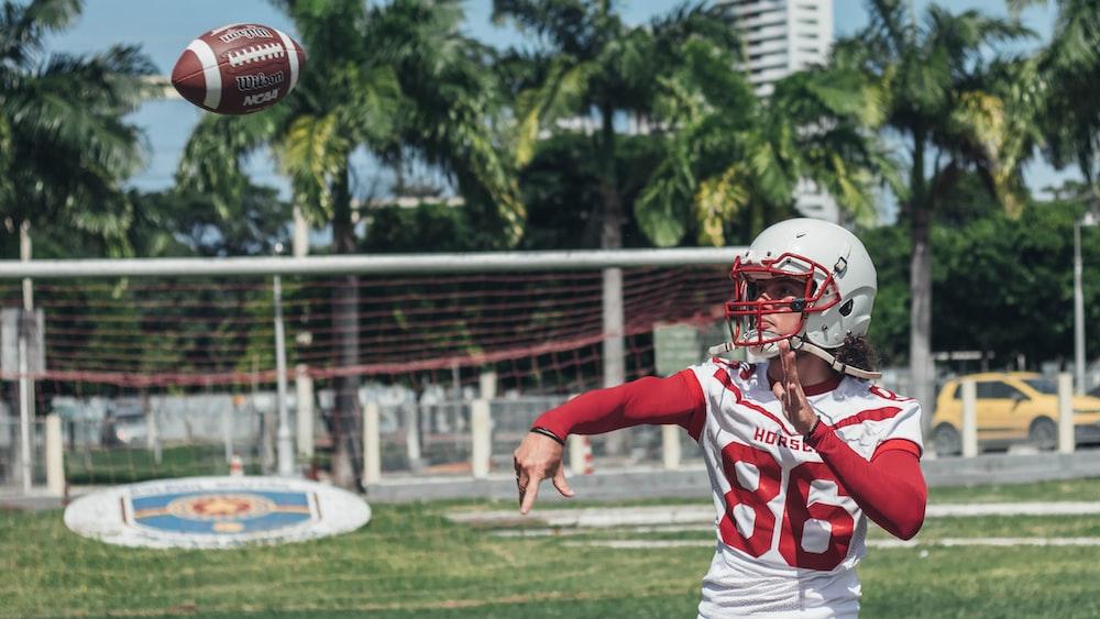 football player throwing footbal