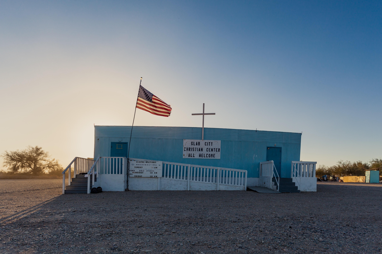 blue concrete building with USA flag