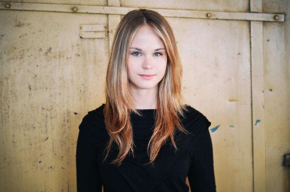 portrait photography of woman wearing black sweatshirt