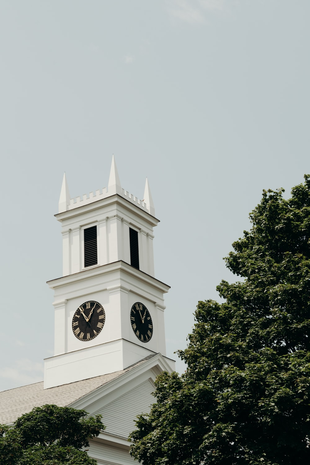 white clock tower showing 11:05