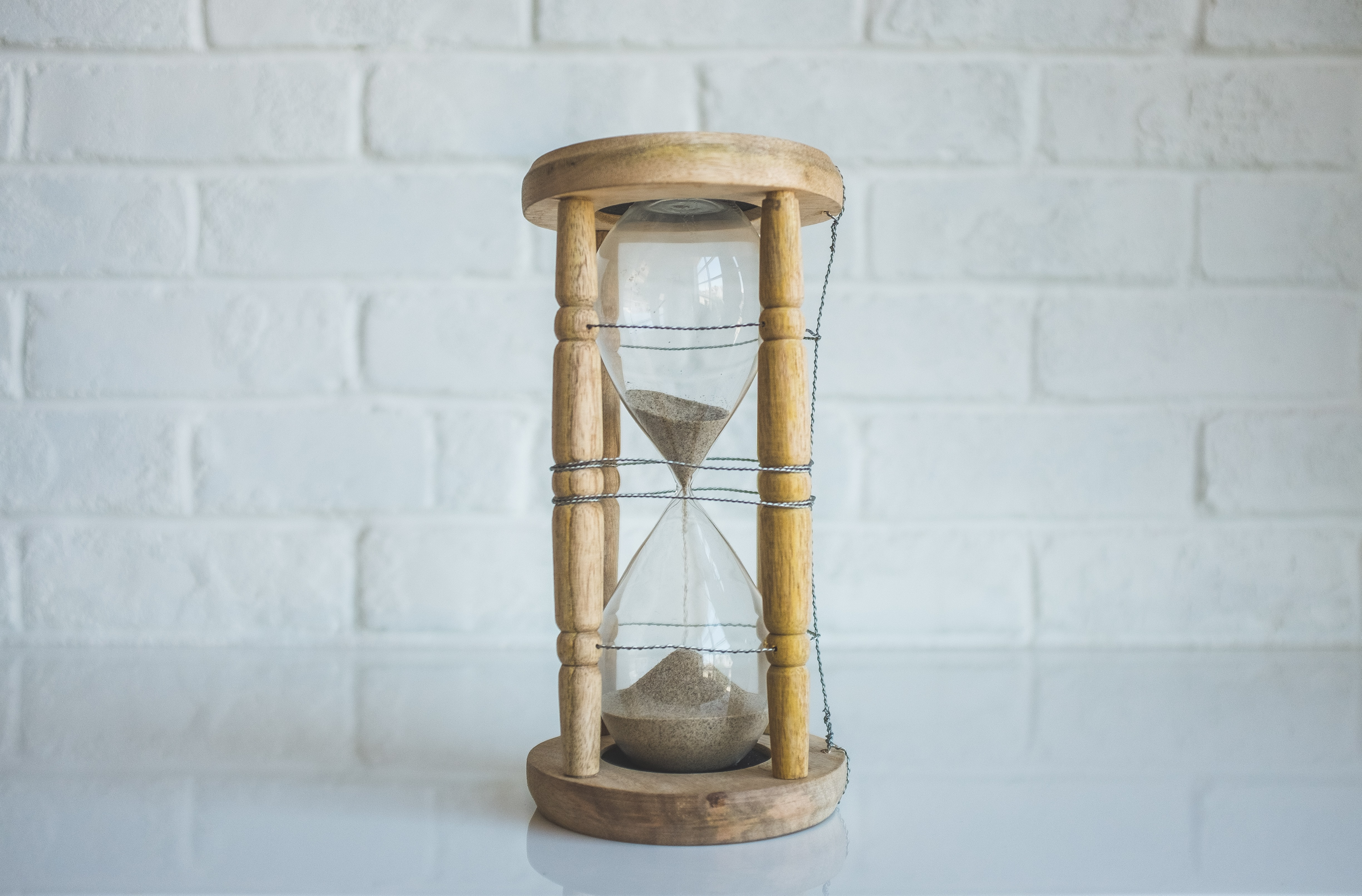 An hourglass with most of its sand on its bottom