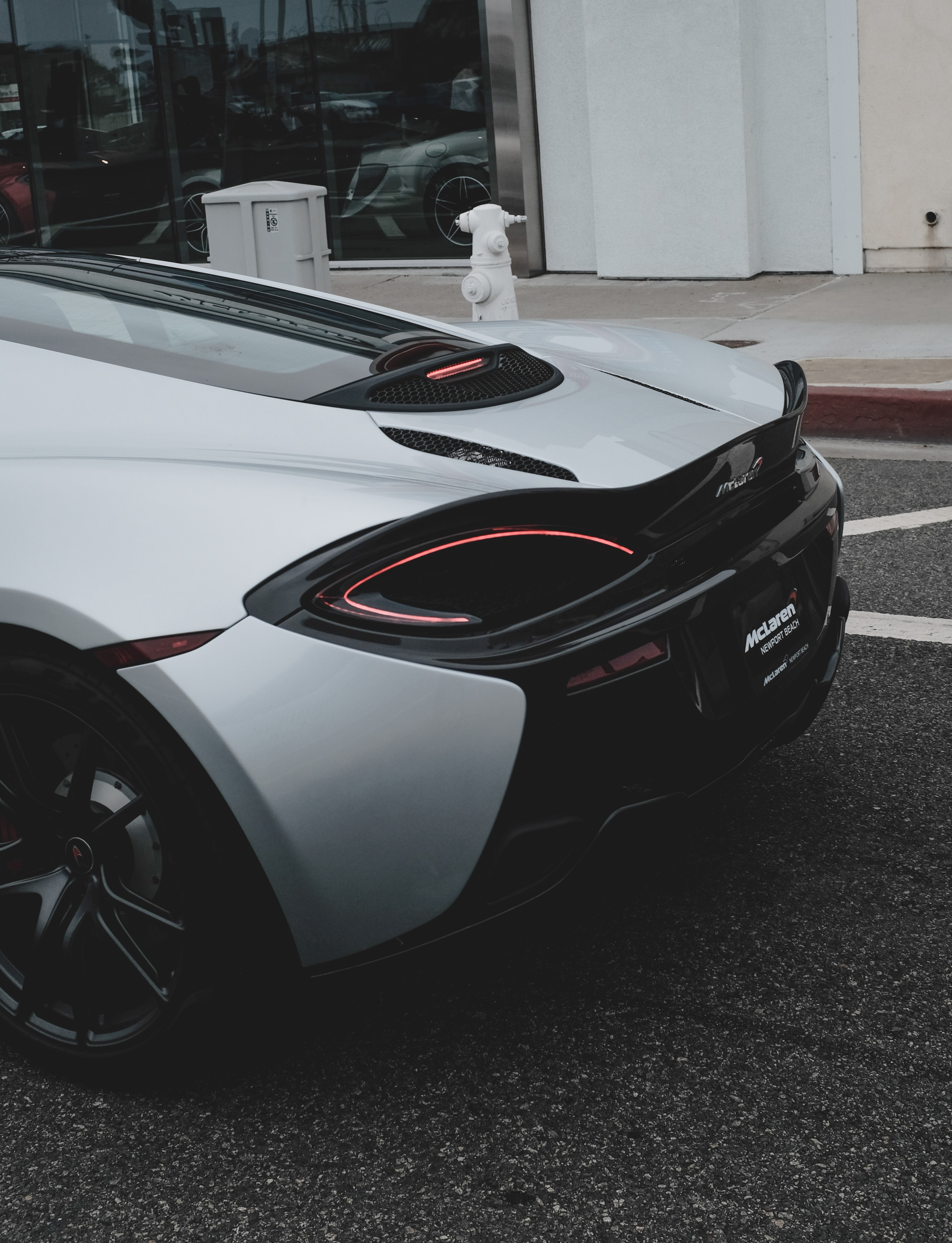 The taillights on a white sports car.