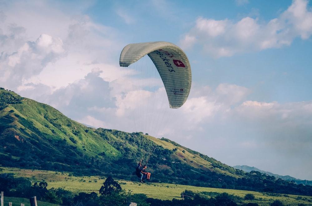 paraglider under blue sky
