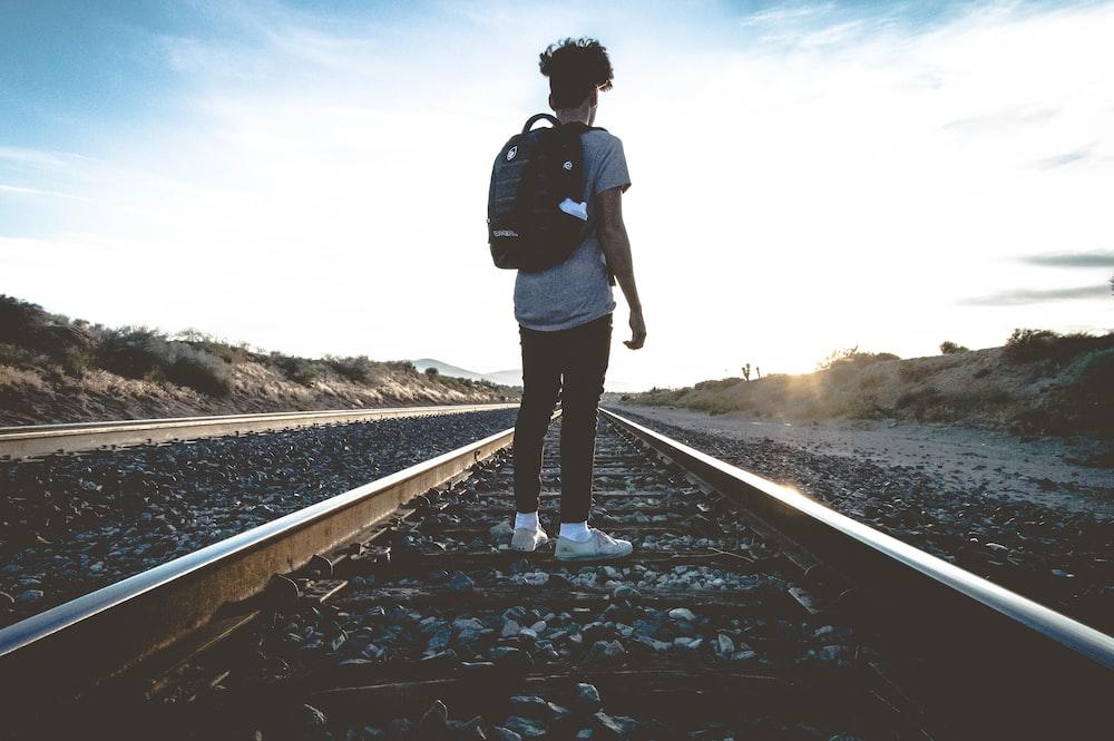 person standing in train rail