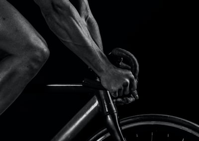 grayscale photography of man riding bicycle sports zoom background
