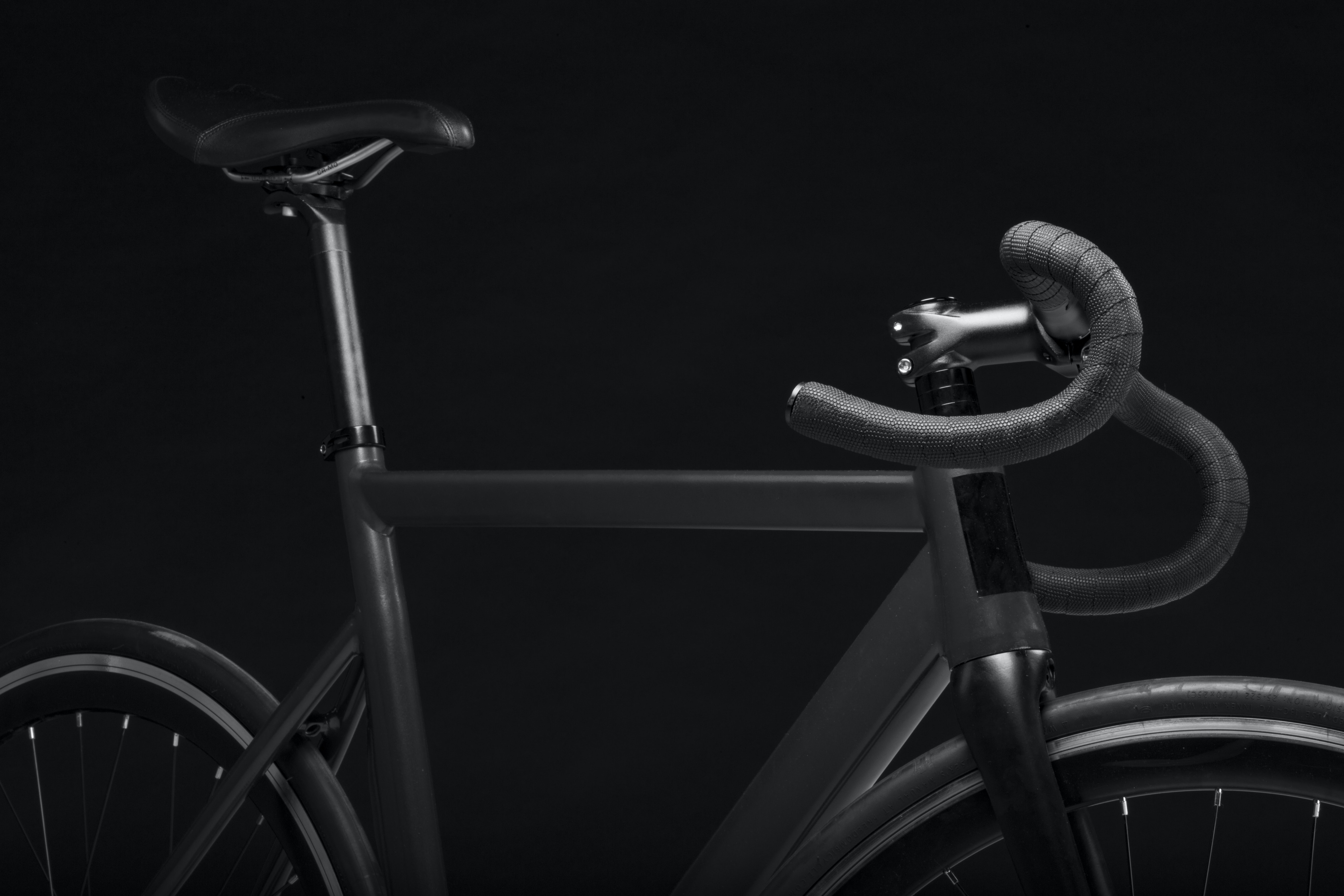 Black and white shot of racing bike from side