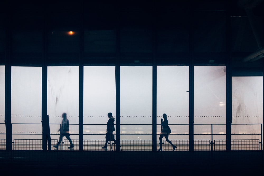 silhouette photography unknown persons walking