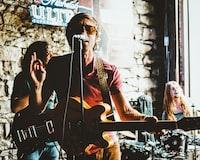 man playing guitar while singing