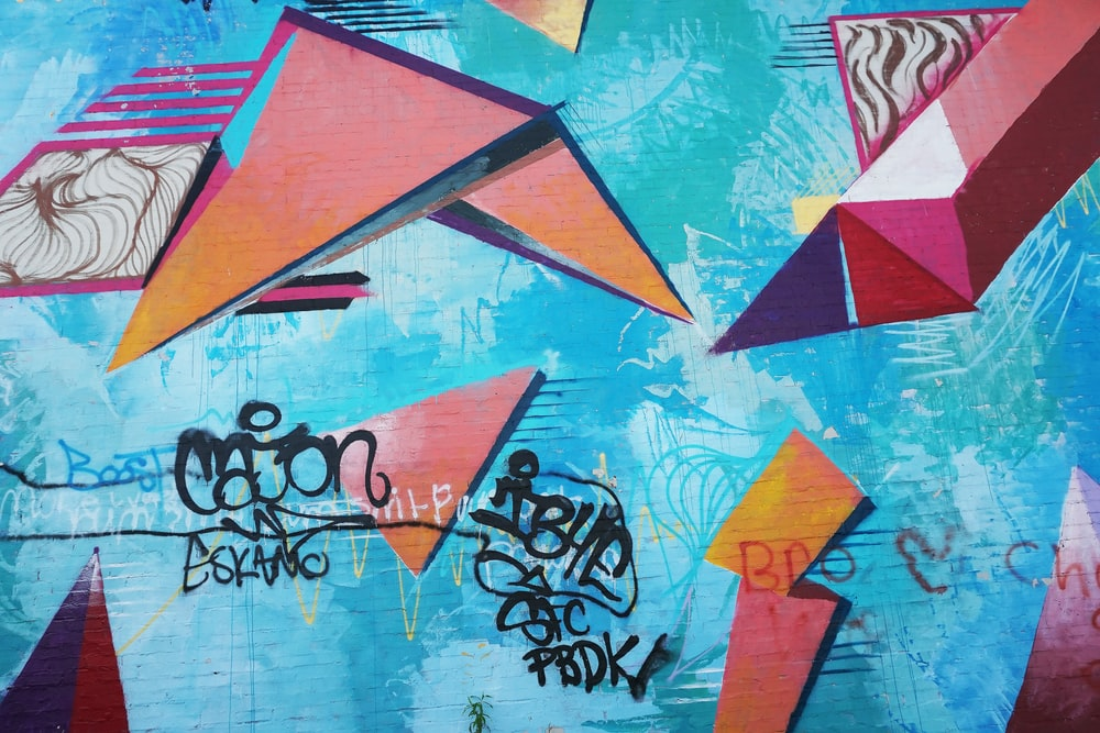 blue and multicolored wall full of graffitis