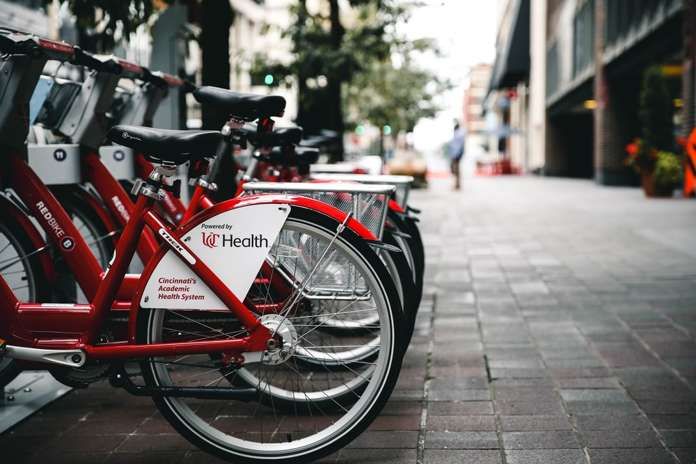 red bicycles parked besides building at daytime