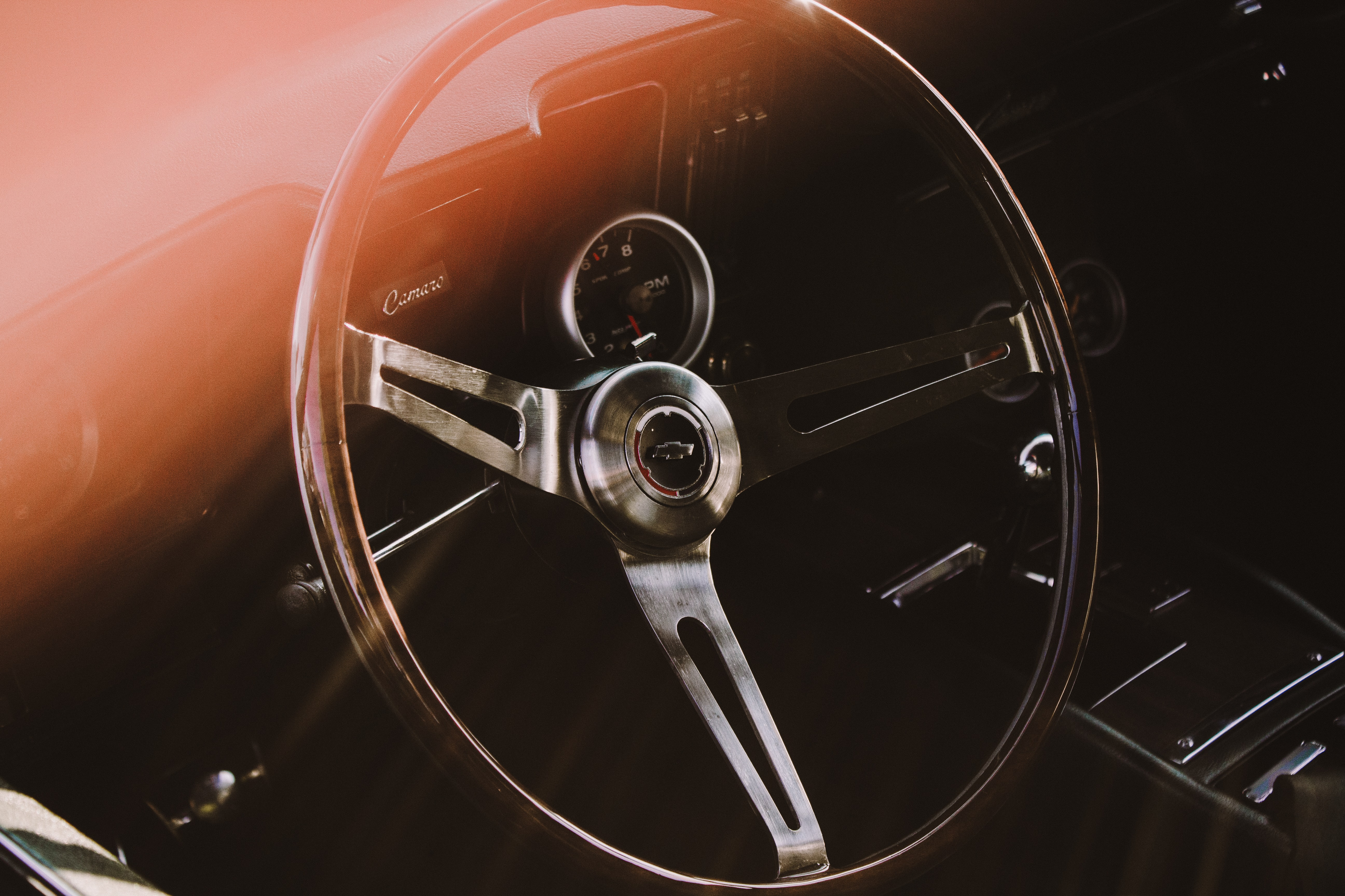 A steering wheel in a classic car.