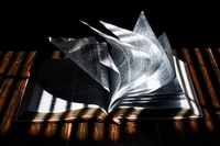 low-light photography of open book