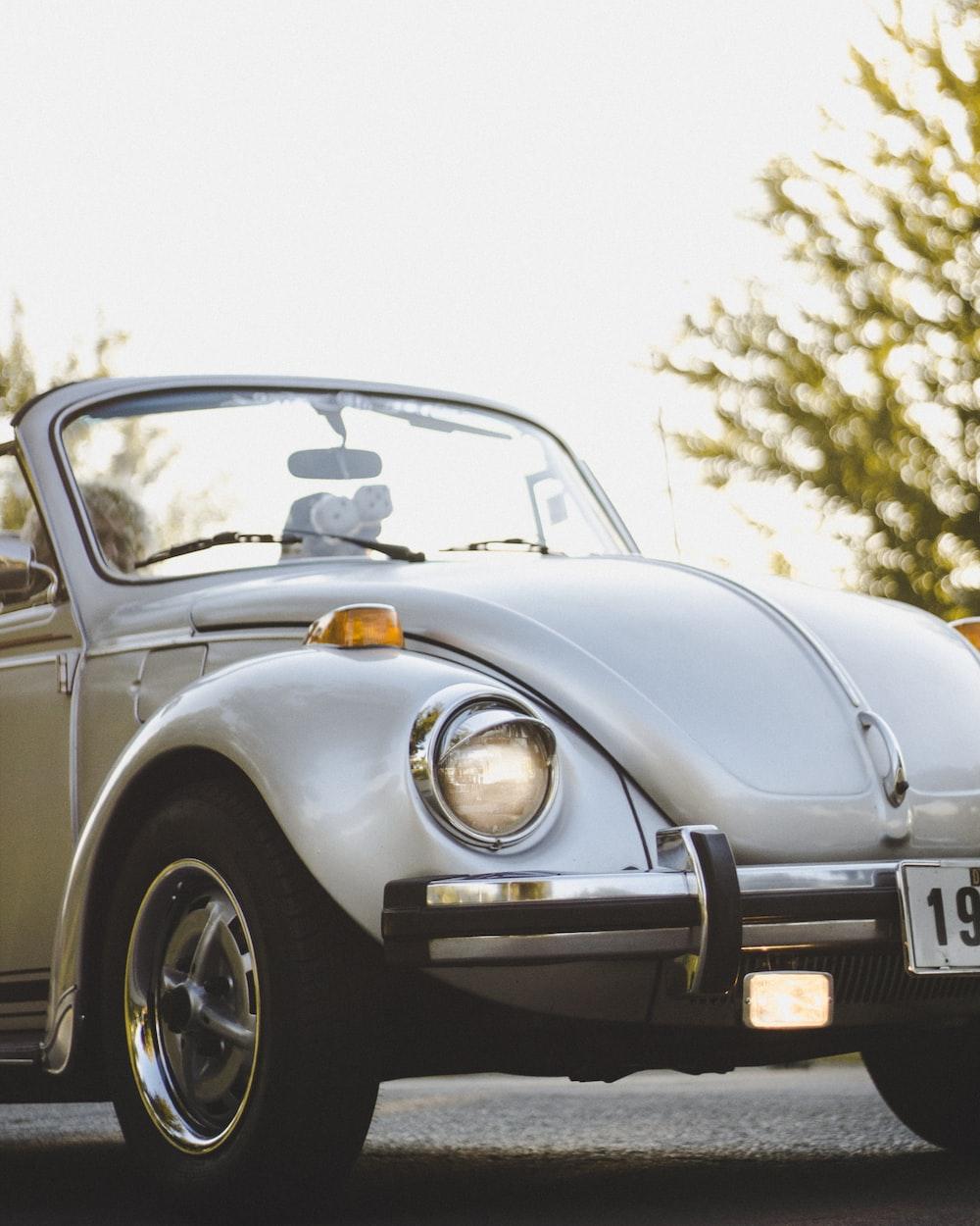 white Volkswagen Beetle convertible