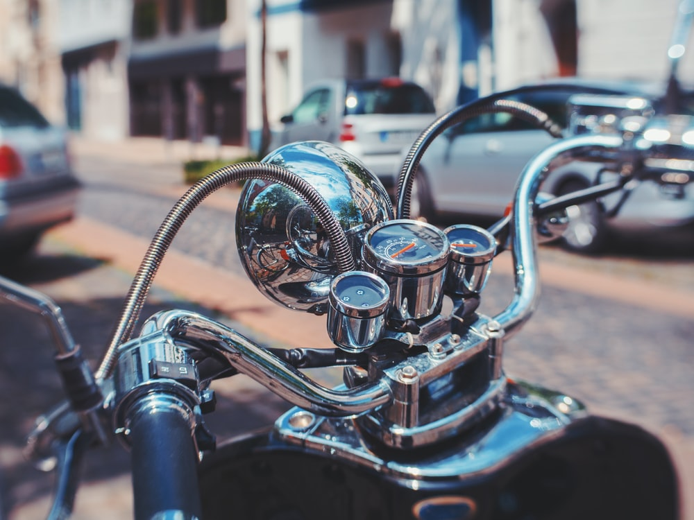 motorcycle near parked cars