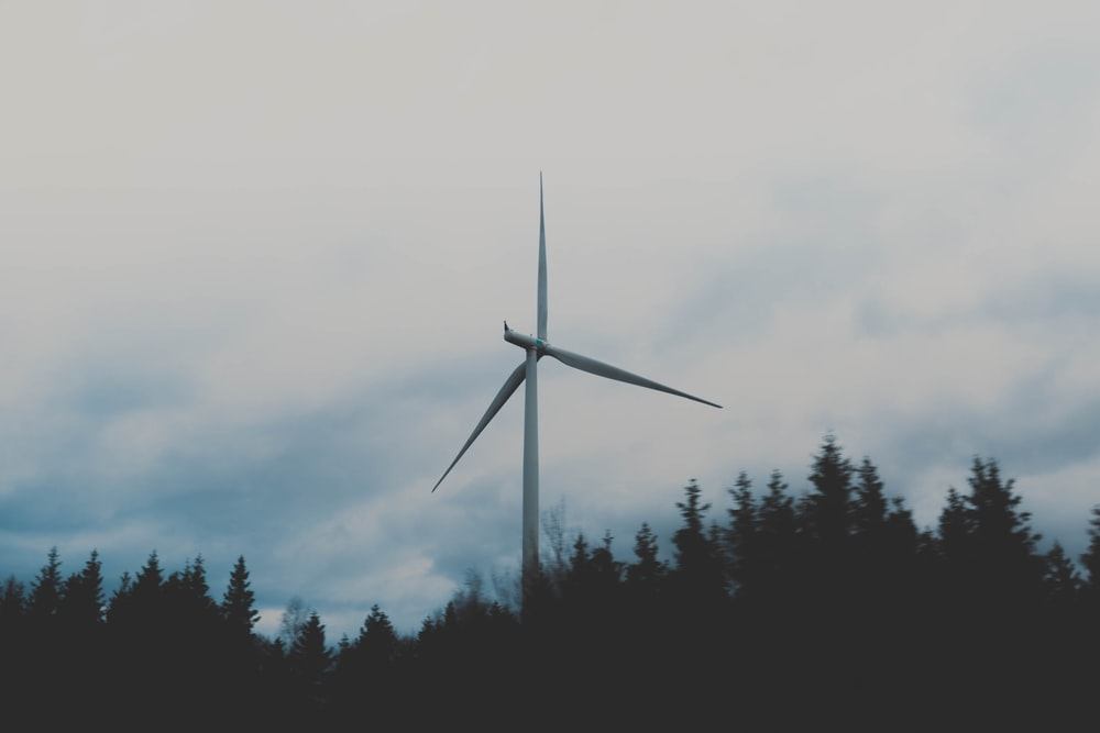 white windmill during cloudy sky