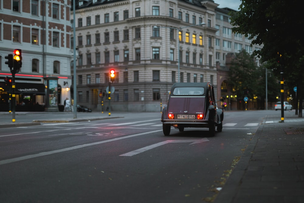 black car on black asphalt