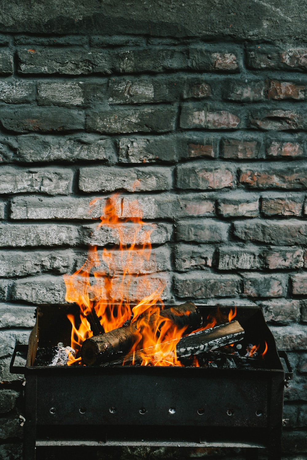 burning logs on charcoal grill