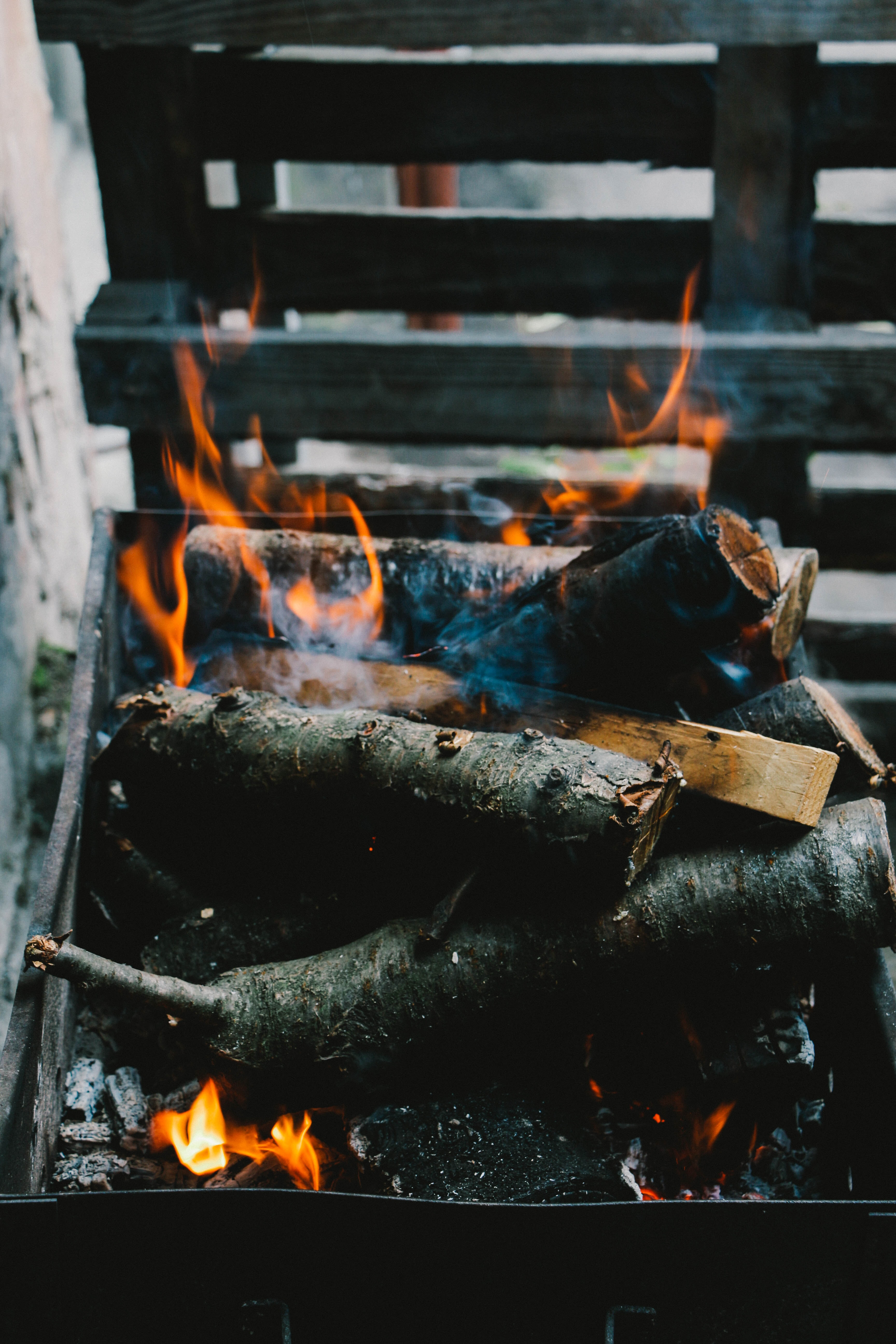 A pile of burning firewood in a brazier