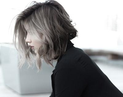 woman in black top hair zoom background