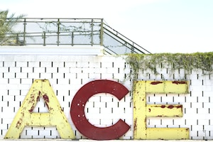 yellow and red ACE signboard