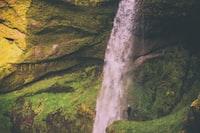 person near waterfalls