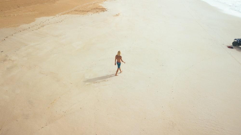 person walking on beach