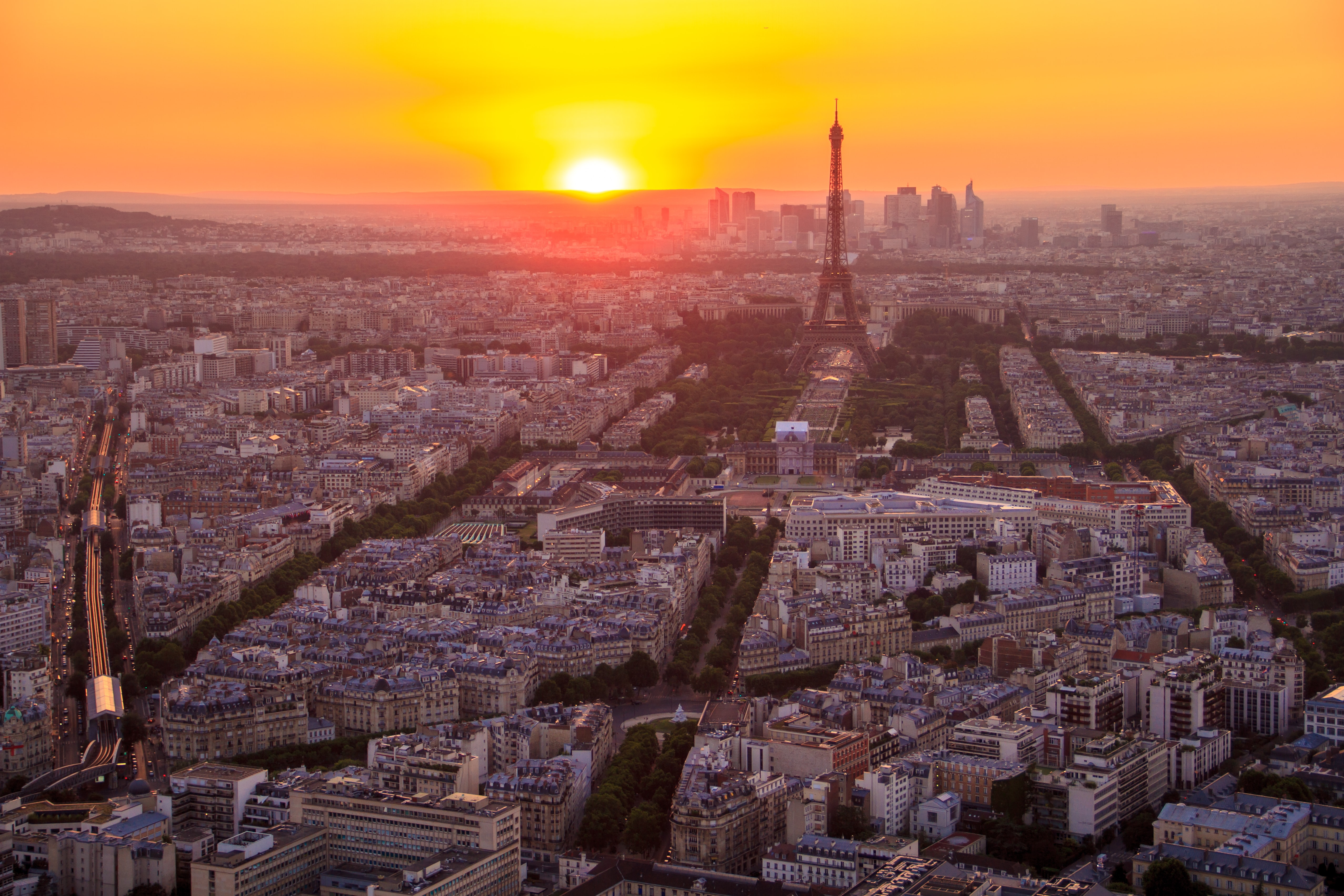 A high view of the Champ de Mars in Paris with the Eiffel Tower during sunset