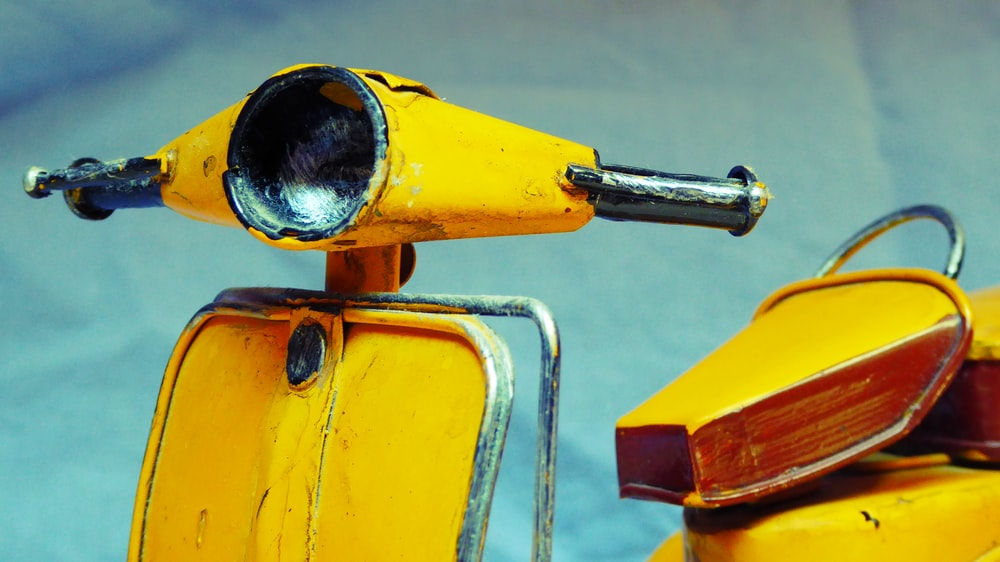 yellow motor scooter
