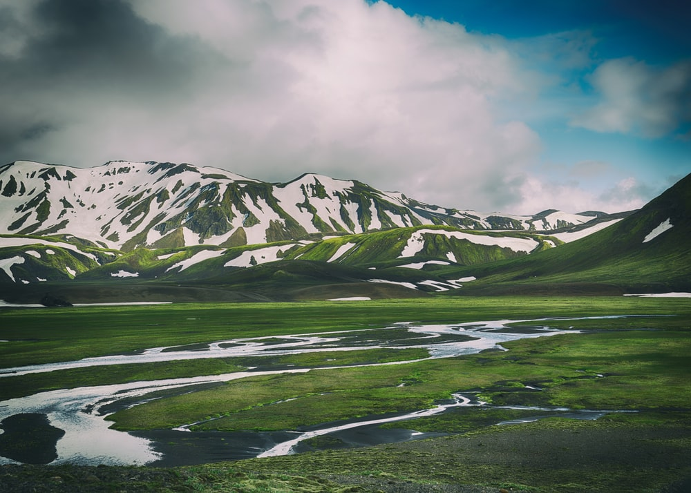 landscape photo of green and white mountains