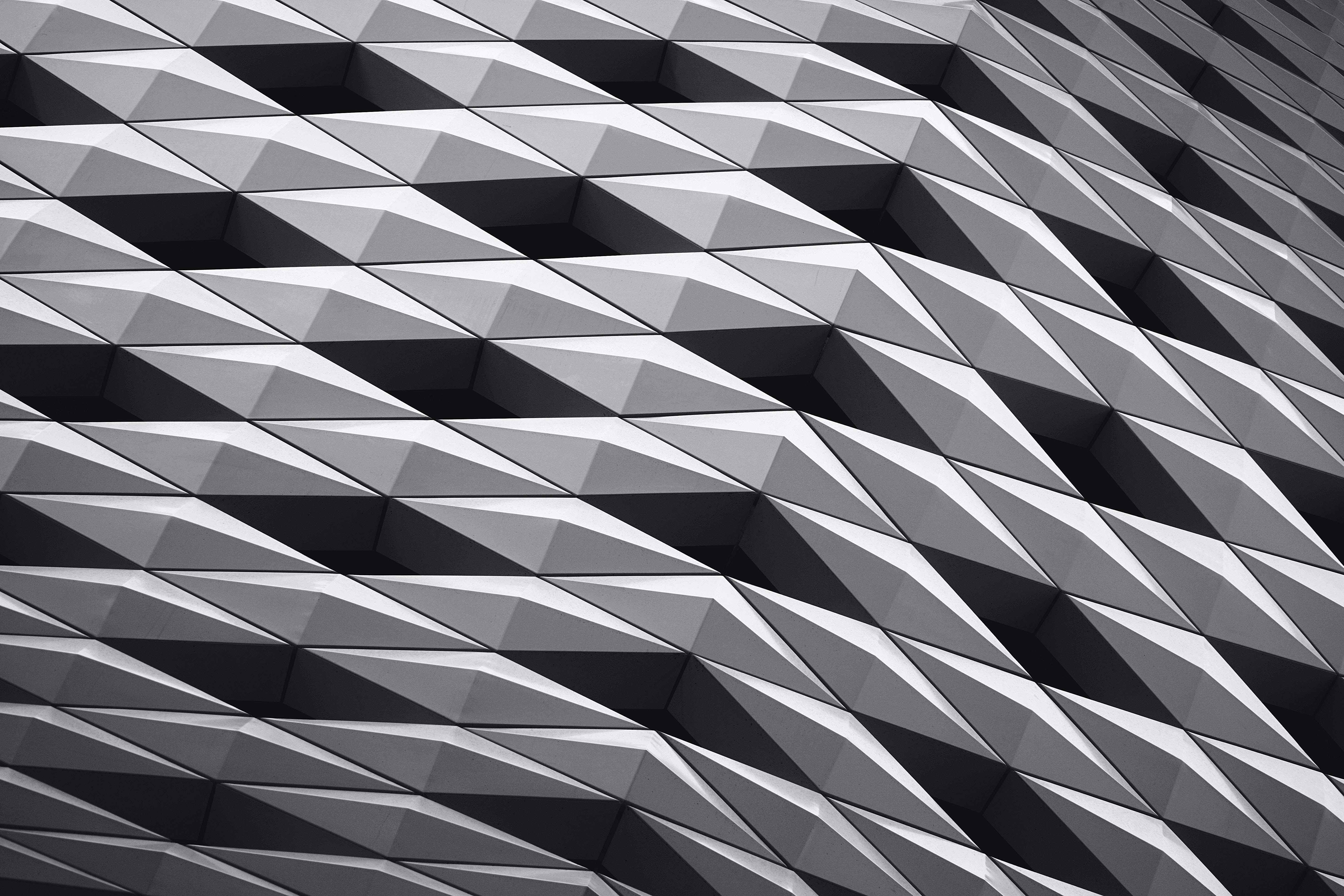 A building facade with a pattern made of black and white diamond shapes on