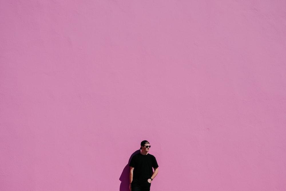 man in black shirt on pink background