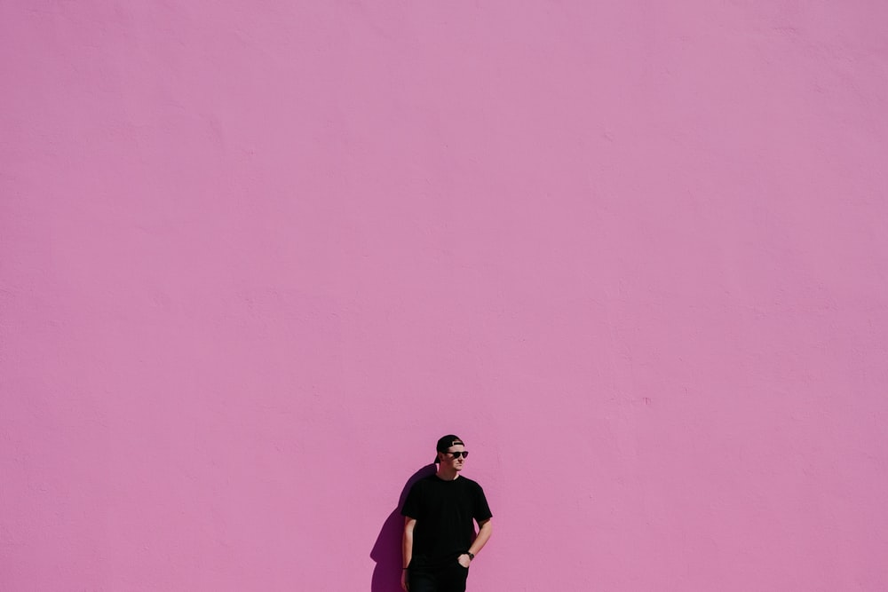 man in black shirt on pink background
