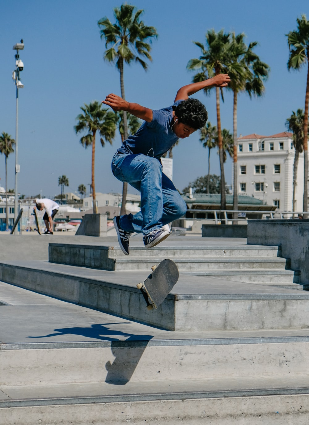 man playing skateboard on gray concrete stairs