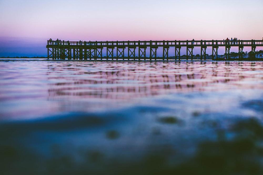 bridge dock above body of water