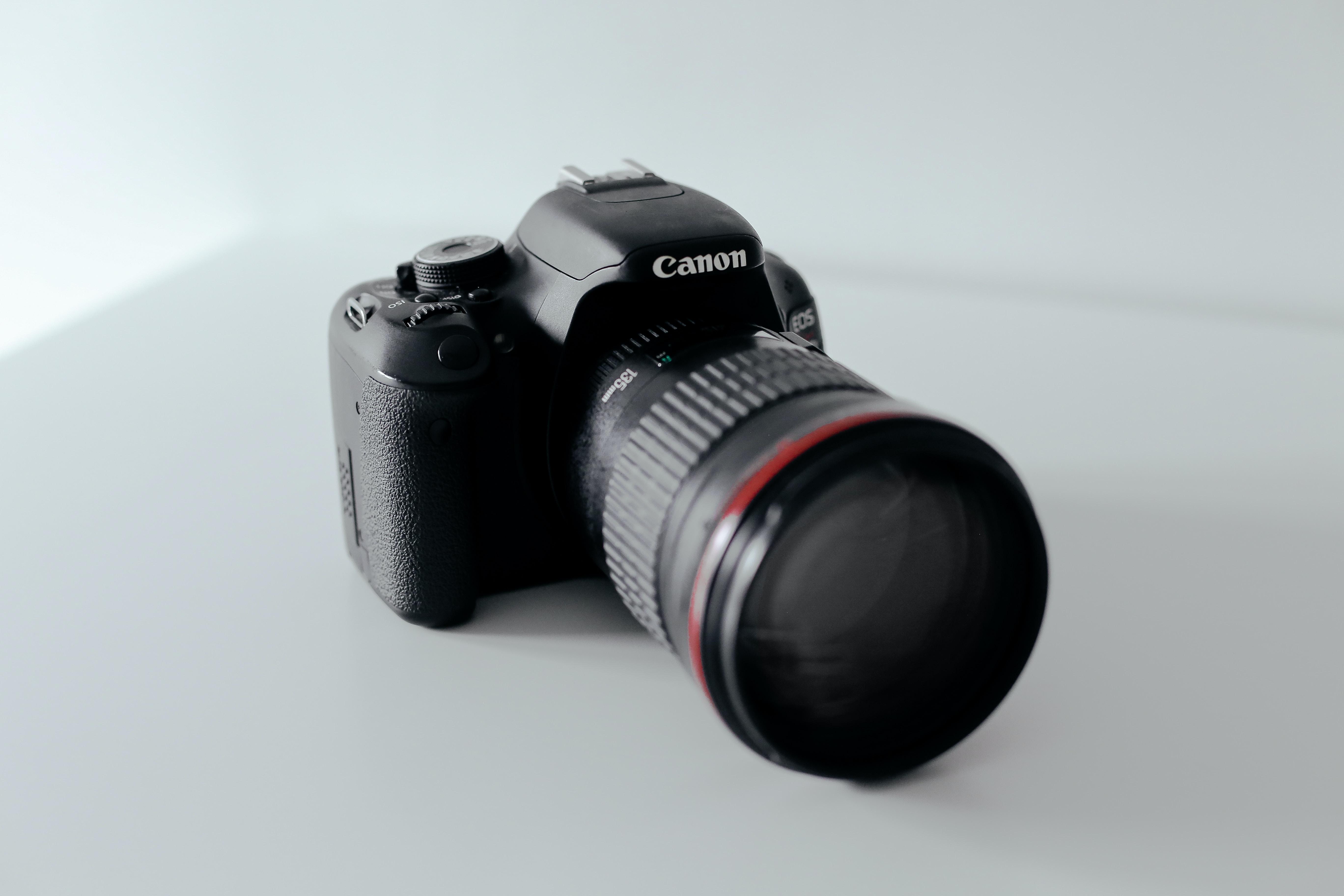Canon EOS DSLR camera in a white studio