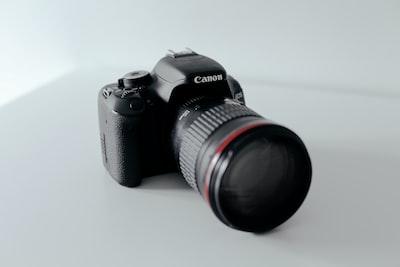 black canon dslr camera canon zoom background