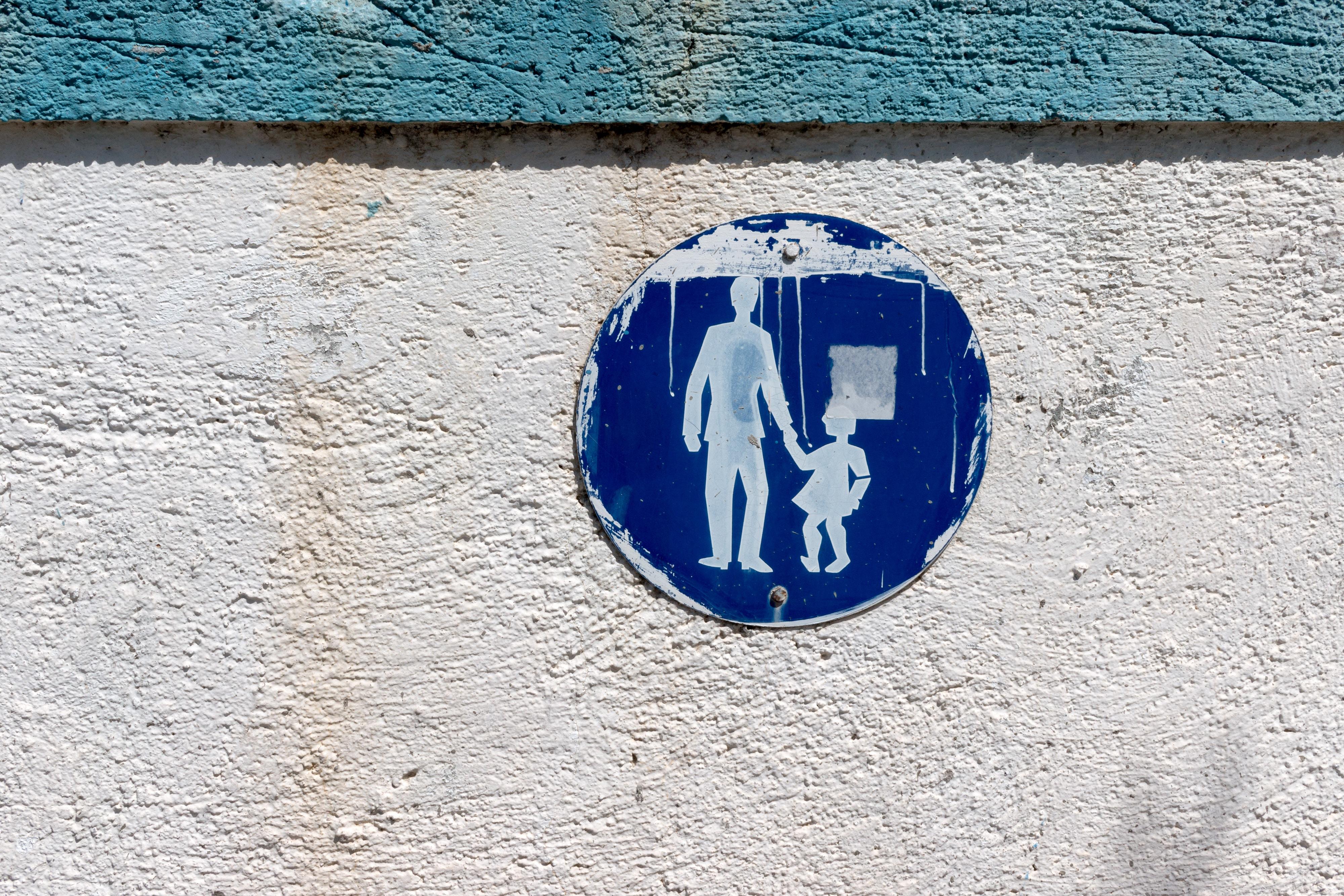 Blue sign on an old facade wall at Mastichari Beach