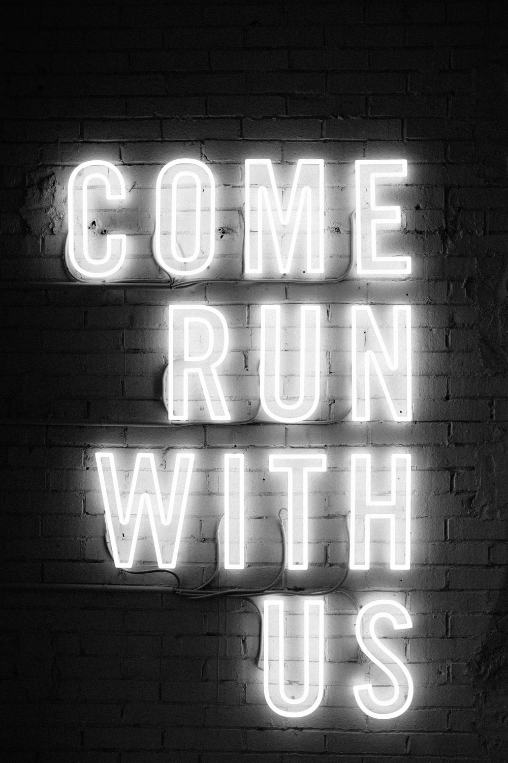 white Come Run With Us neon signage