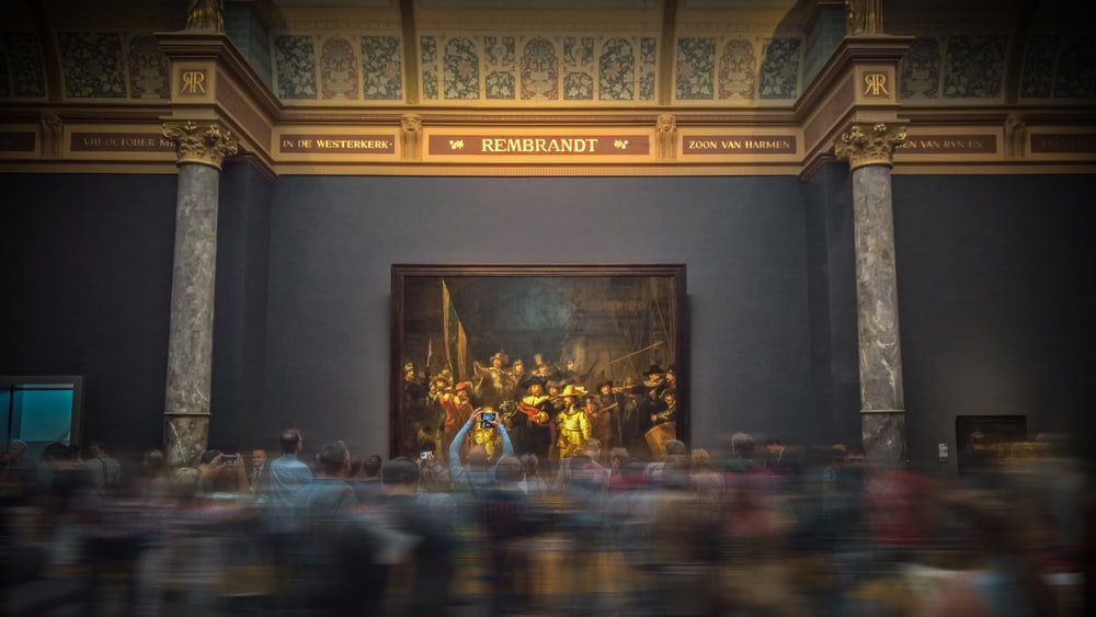 selective focus photography of group of people painting