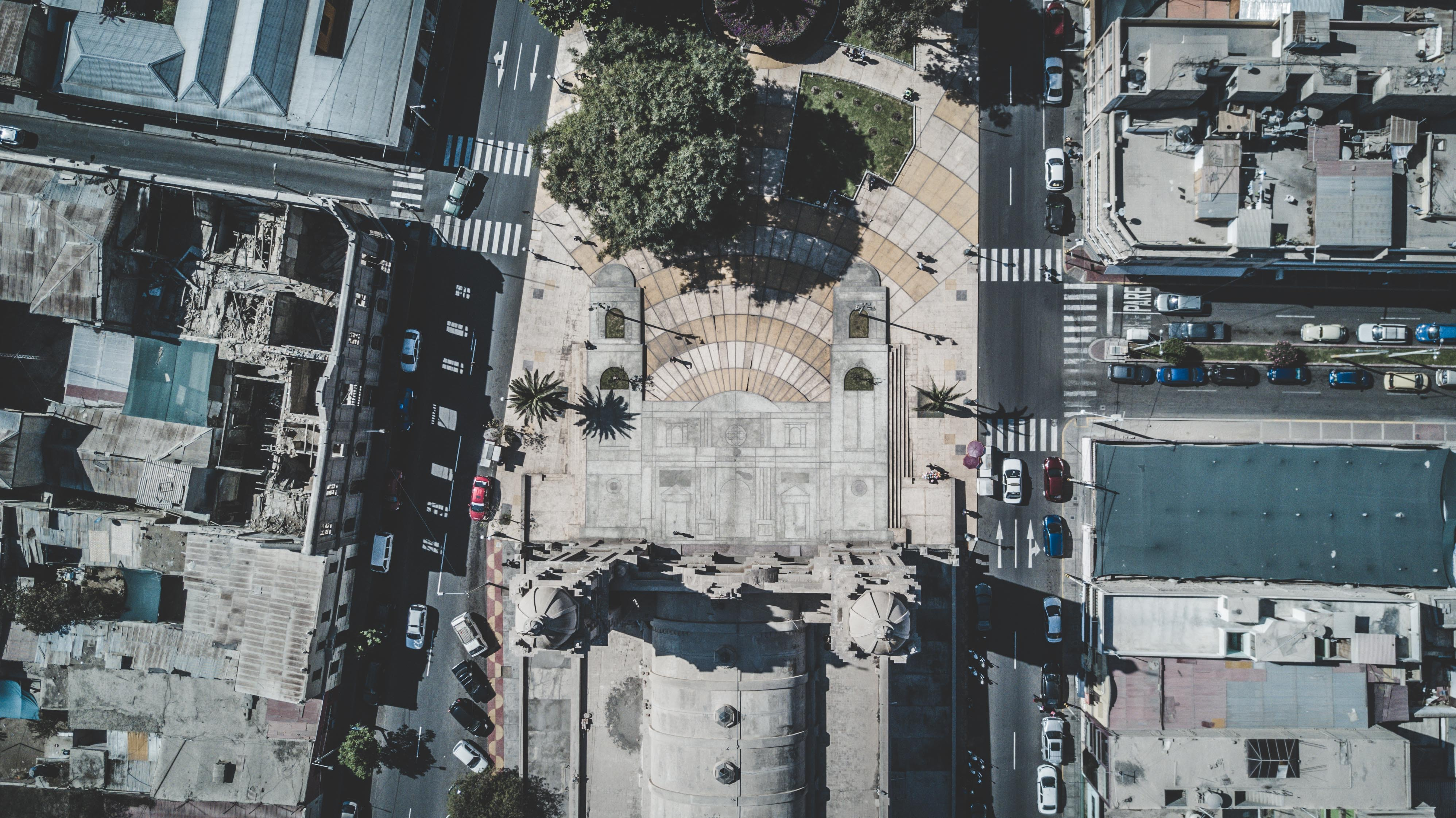 A drone shot of a cathedral and an urban neighborhood in Tacna, Peru