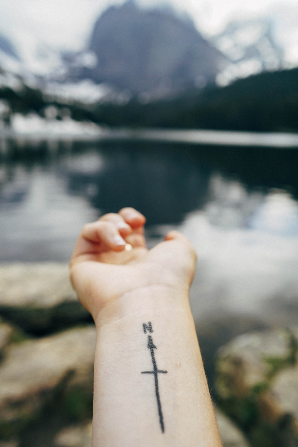 person with wrist tattoo of North