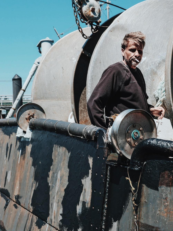 man standing on ship at daytime