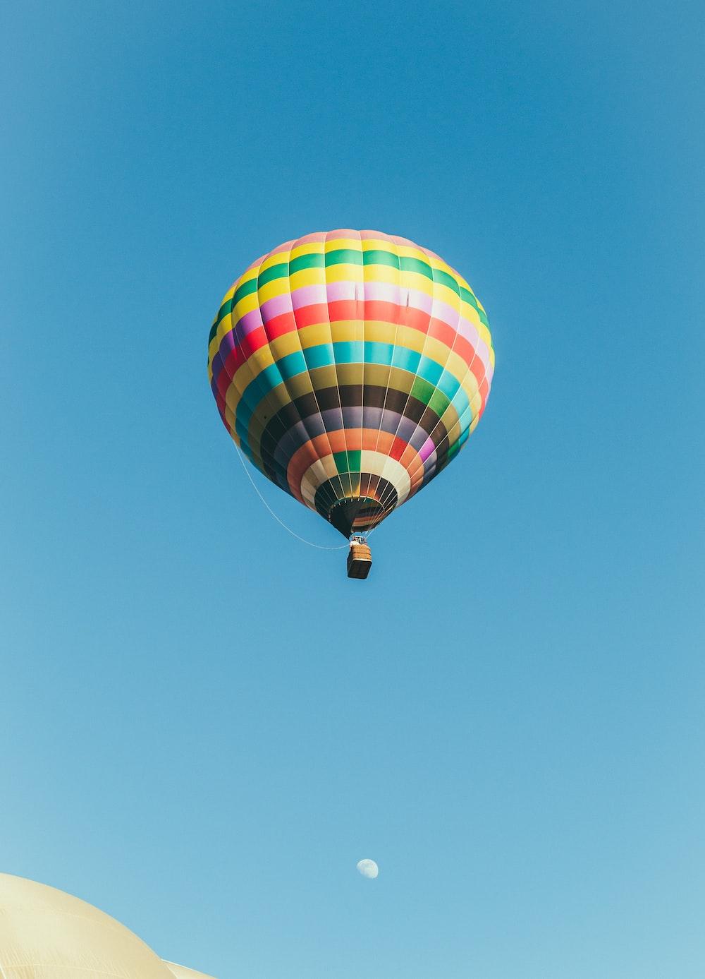 multicolored hot air balloon under blue sky