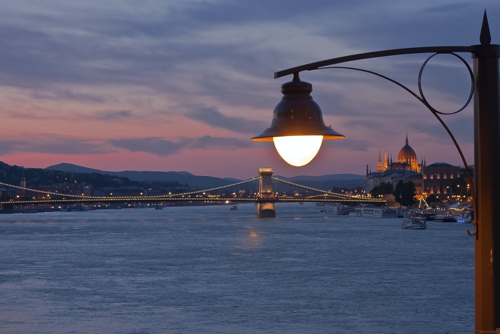 post lamp in front of bridge
