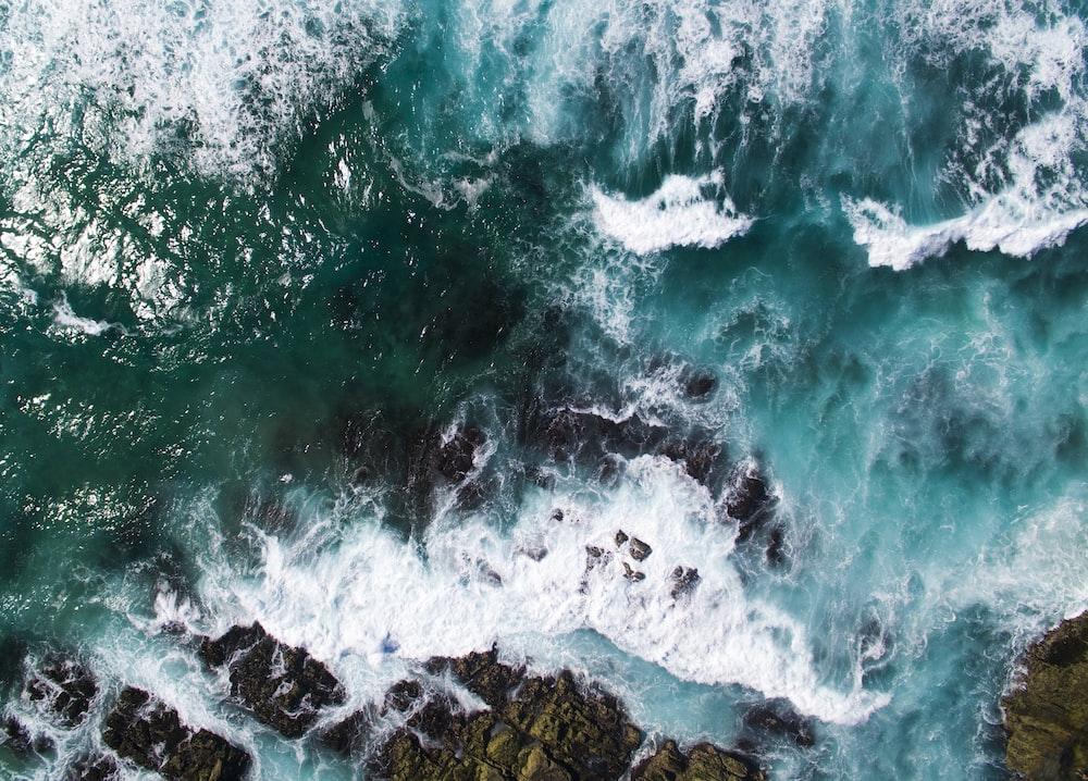 aerial photography of seashore waves